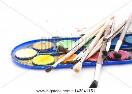 Set Of Watercolor Paints With Brushes On White Background