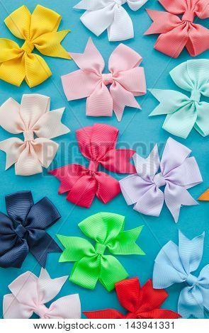Bows in various colors on blue background