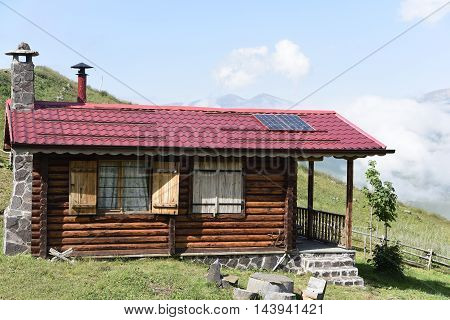 traditional plateau house at mountain with fog
