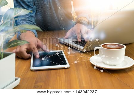 Business Man Hand Working On Laptop Computer On Wooden Desk With Network Diagram
