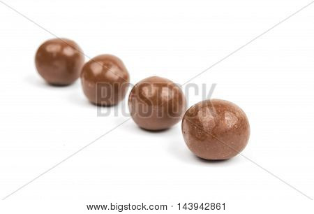 Dark brown dragee in chocolate covered dessert