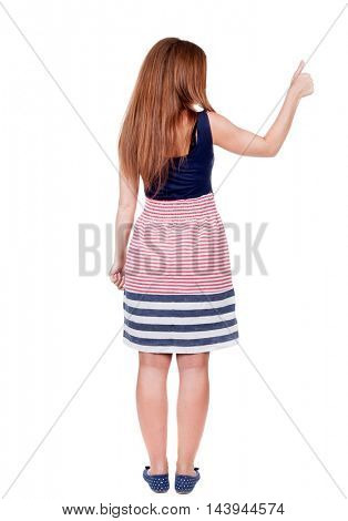 Back view of  woman thumbs up. Rear view people collection. backside view of person. Isolated over white background. slender redhead in dress shows the symbol of success or hitchhiking