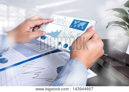 Documents On Office Table With Laptop Computer And Digital Graph Business