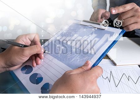 Documents On Office Table With Digital Tablet And Man Working