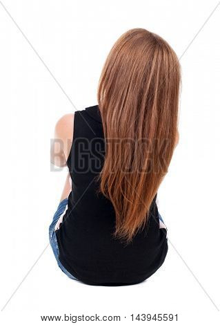 Back view beautiful young woman sitting on floor and looks into distance. redhead girl relaxes. Rear view people collection. backside view of person. Isolated over white background.