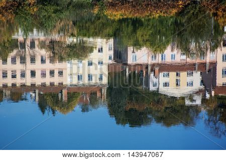 Modern french houses are reflected in the river