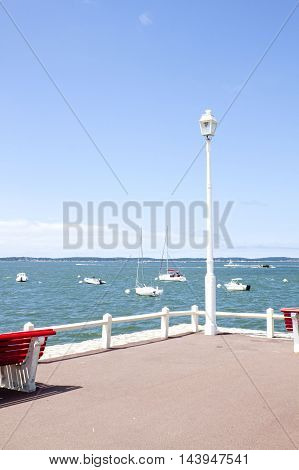 Lamppost In A Pier In The Coast Full Of Boats, France