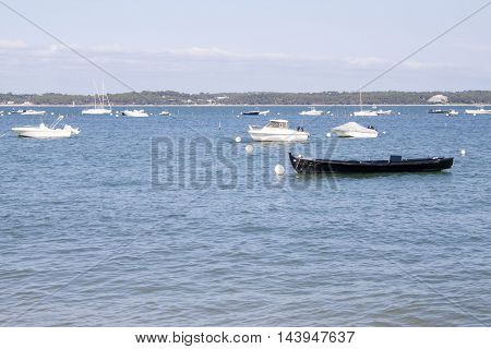 Motor Boats And Sail Boats Moored In The Coast Of France