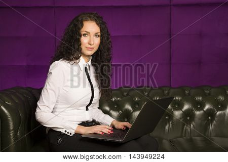 Portrait of a beauty attractive and sensuality pretty young adult brunette business woman using laptop at office