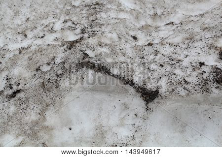 The dirty surface of an ice field in the Alps.
