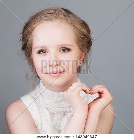 First Love. Cute Girl Smiling and Making Heart