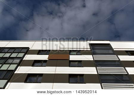 Modern Residential Building Against Cloudy Sky.