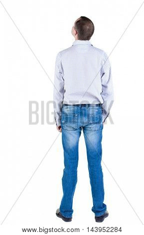 young expert looks ahead. rear view. Isolated over white .