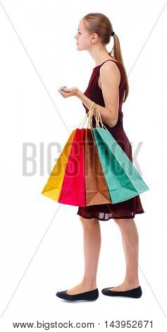 back view of woman with shopping bags. backside view of person.  Rear view people collection. Isolated over white background. Slim blonde in a burgundy dress shopping.
