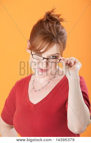Woman Holds Eyeglasses