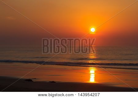 Pink sunset in ocean. India, Andaman island. Beach orange evening