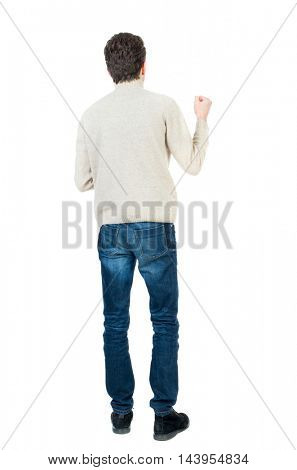 Back view of man . Standing young guy. Rear view people collection.  backside view of person.  Isolated over white background. Curly short-haired man in a woolen white jacket bent arm in a gesture of