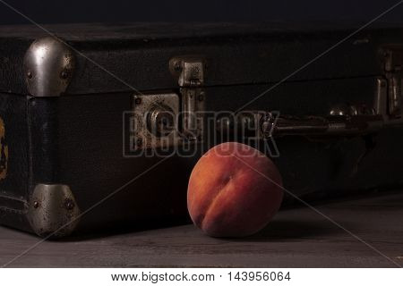 Still Life With A Package And Peaches