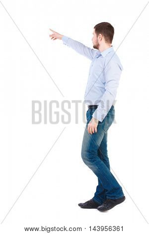 Back view of going  business man pointing. walking young guy . Rear view people collection.  backside view of person.  Isolated over white background. Bearded businessman in white shirt. It goes hand