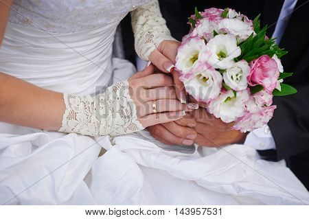 Beautiful wedding bouquet in brides and grooms hands.