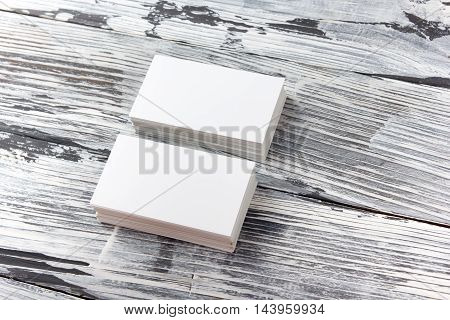 White blank business visit card, gift, ticket, pass, present close up on black and white background. Copy space Blank corporate identity package business card Template for ID