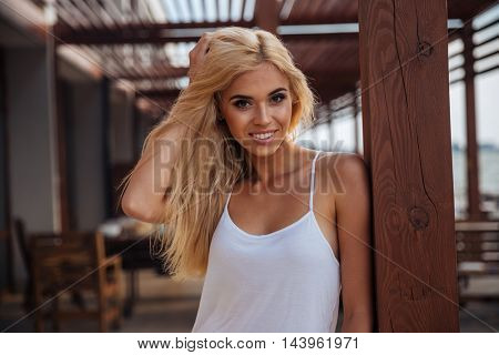 Closeup portrait of a beautiful cheerful young woman