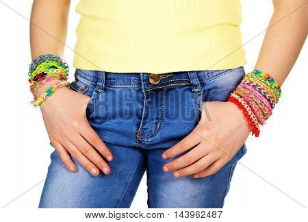 Hands in pocket teen girl with trendy handmade weaving bracelets on a white background