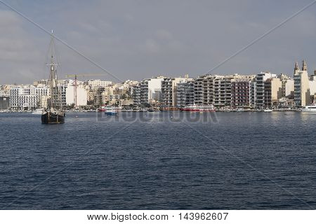 Sliema, Malta - August 03 2016: Sliema skyline and moored cruise ships. Sliema's coastline is the starting point of most ferry cruises to Gozo and Comino islands.