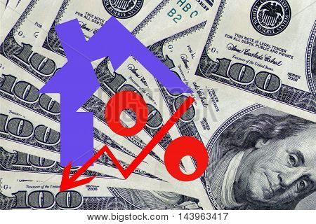 Red percent sign on a background of money . The concept of price changes on the real estate market