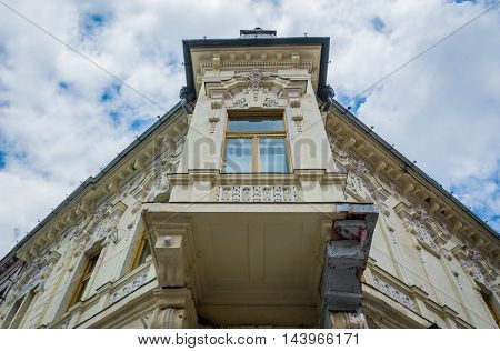Bay window of old tenement house in Brasov city in Romania
