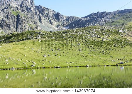 beautiful green nature with blue sky at mountains