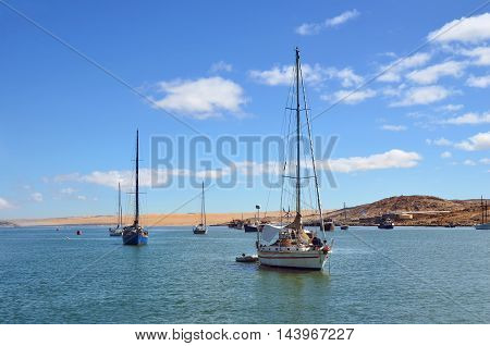 LUDERITZ NAMIBIA - JAN 26 2016: Sailing yachts in port of Luderitz at sunrise Luderitz is a harbour town lying on one of the least hospitable coasts in Africa