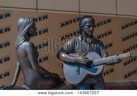 YEKATERINBURG RUSSIA - AUGUST 24 2013. Sculpture monument to the famous Russian poet singer and actor Vladimir Vysotsky and French actress Marina Vlady