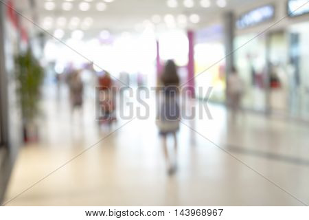 Abstract blurred image of shopping mall and people for background usage .