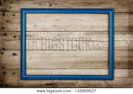 abstract blue frame on weathered wooden planks