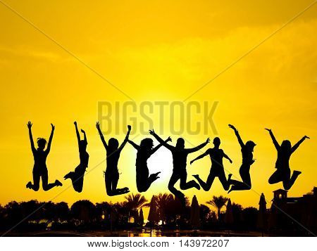 Backlit Group Dance the Night Away