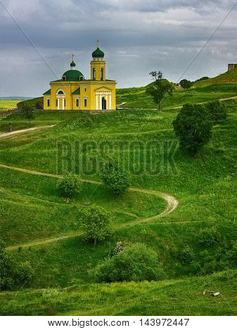 Church of Alexander Nevsky in Khotyn on green hills. Ukraine