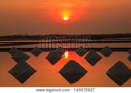 Sunset in Salt farming at the coastal Phetchaburi provinces of Thailand Edit warm tone.