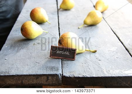 natural food idea, Juicy flavorful pears on a wooden table