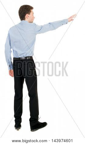 Back view of pointing business man.  Rear view people collection.  backside view of person.  Isolated over white background. Businessman in a shirt and a bow tie is back and shows his hand.