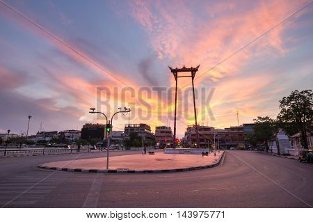 The Giant Swing in sunrise time with Temple of Buddha (Bangkok Thailand)
