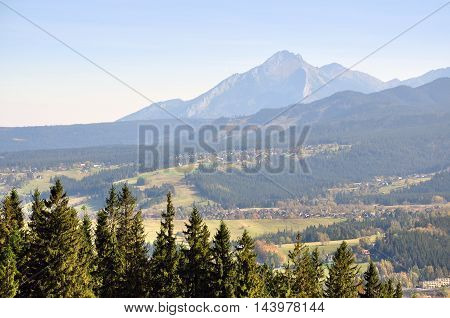 Mountains Zakopane in Poland in the fog in perspective. Spruce forest in the foreground.