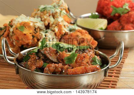 asian food aubergine curry bainghan bharta with coriander garnish