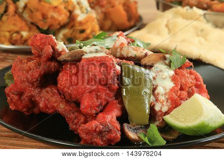 spicy tandoori chicken wings with peppers and mushrooms