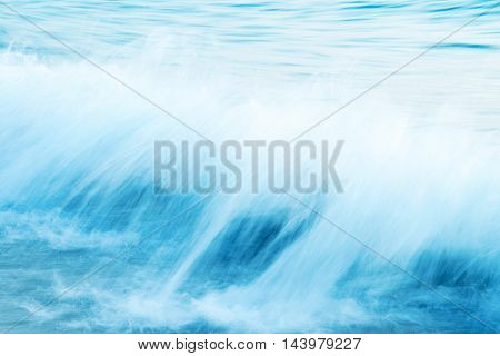 Abstract image of splasing sea waves intentional long exposure
