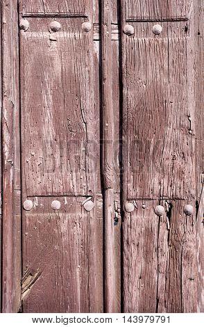 old wooden door color brown with metal rivets