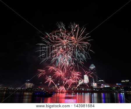 Fireworks bursting over the city of Cincinnati and the Ohio River during the 4th of July celebration 2015 Cincinnati Ohio USA