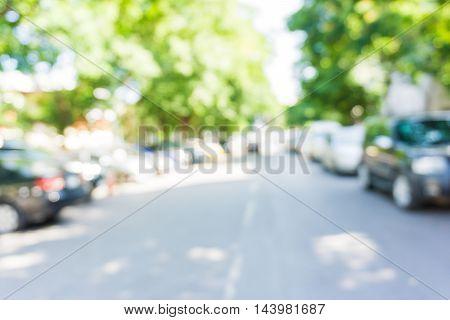 Defocus Of Car Park Under Green Tree