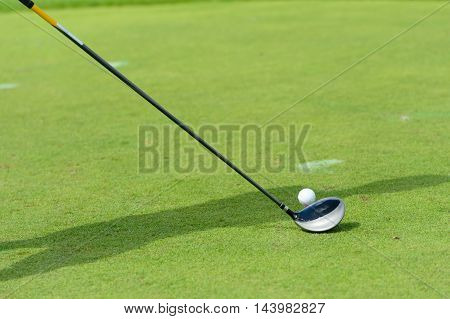 Golf club and ball in grass, thailand