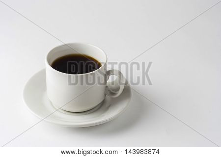 Cup Of Coffee On A White Table.